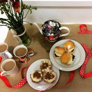 a simple morning tea with scones, pies and tes.