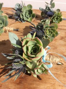 Deluxe Buttonholes- A Touch of Class Florist