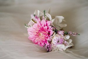 a pink dahlia and hydrangea bridal headpiece.