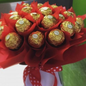 a chocolate bouquet made of 30 ferrero rocher chocolates wrapped in in red cellophane.