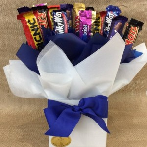 a chocolate bouquet of mini cadburys and nestle chocolates wrapped in blue and white.