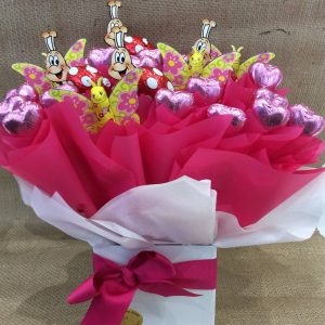a pink chocolate bouquet using storrs chocolate butterflies and lady birds and pink lady hearts.