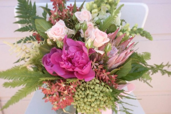 Glass vase arrangment in pinks- A Touch of Class Florist