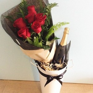 Sparkling Roses is a beautiful combination of 6 red roses, and bottle of sparkling wine and a tin ice bucket - A Touch of Class Florist