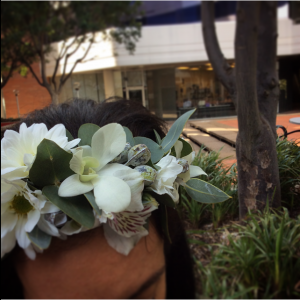 a white half flower crown made using seasonal white flowers.