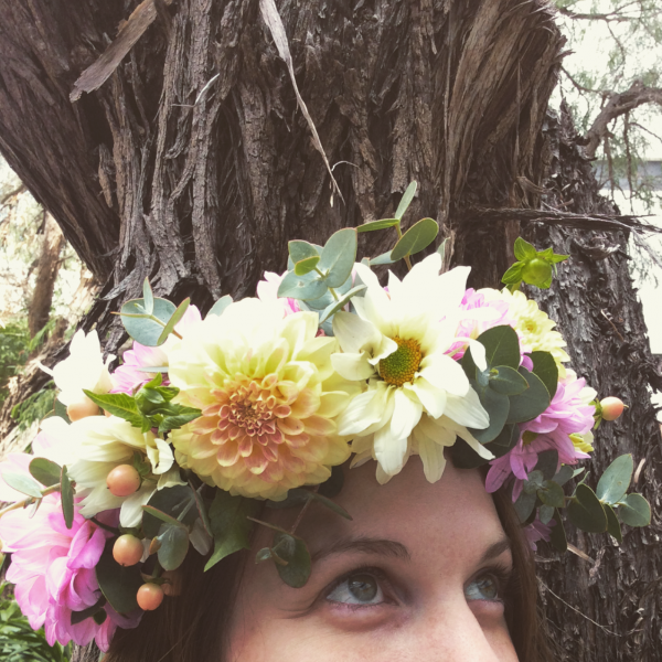 a full flower circlet made using fresh seasonal flowers like dahlias.