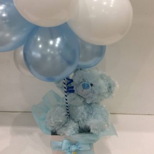 a cluster of blue and white balloons with a blue fluffy teddy
