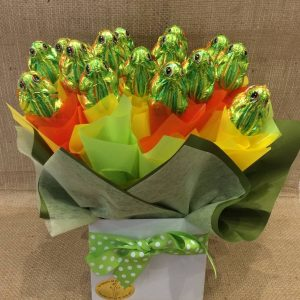 a chocolate bouquet of green chocolate frogs wrapped in yellow, green and orange.