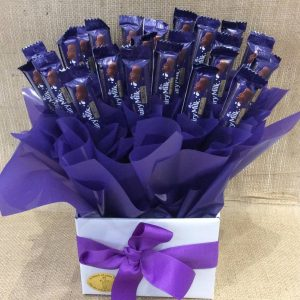 a purple and white chocolate bouquet of dairy milk chocolate