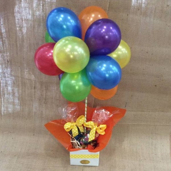 6 brightly coloured latex balloons made into a topiary. with two clear bags of jellybeans