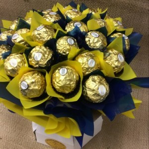 a chocolate bouquet of 30 ferrero rocher chocolates wrapped in blue and yellow to honour the west coast eagles