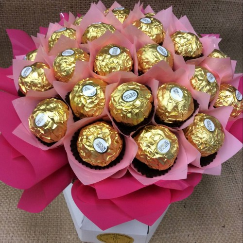 a chocolate bouquet of 30 ferrero rocher chocolates wrapped in pink