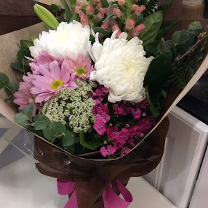 compact posy of seasonal blooms hand-tied and beautifully wrapped