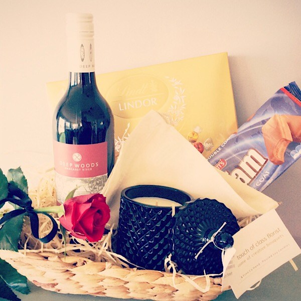 Hamper with red wine, chocolates, Bear and finn candle and a single red rose- A Touch of Class Florist