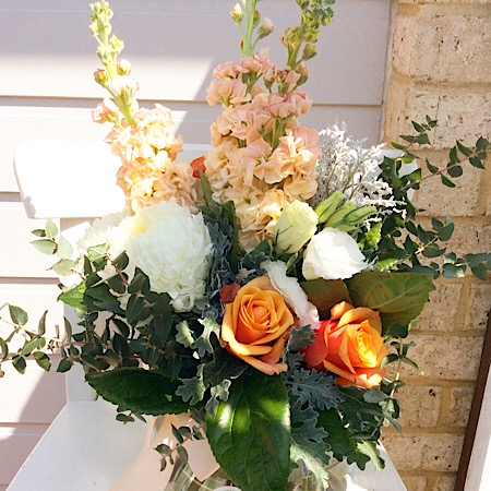 Peachy Keen fishbowl arrangement in white, peach and silver tones- A Touch of Class Florist
