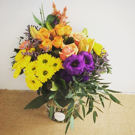 A bright and sweet vase arrangement prefect for a table centrepiece.