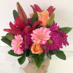 a floral arrangement in pink and orange.