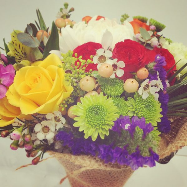a close up image of a bright floral bouquet using seasonal flowers.