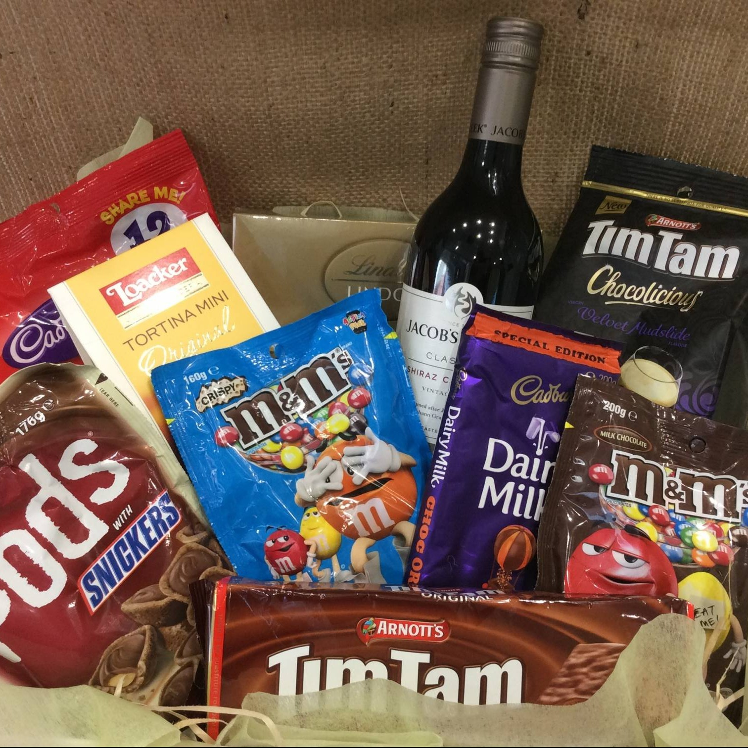Gift baskets perth same day delivery a touch of class florist a hamper filled with chocolate products with a bottle of red wine negle Image collections
