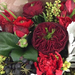 a close up image of a red floral bouquet.