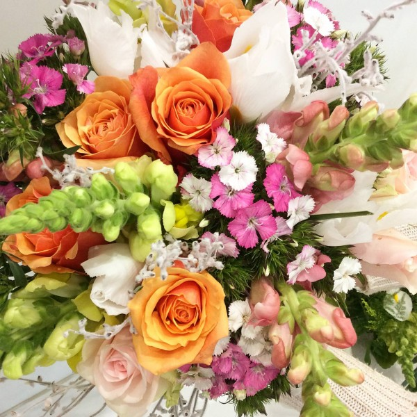 a brightly coloured bouquet of seasonal flowers.