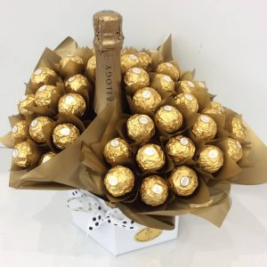 a chocolate bouquet of 40 ferrero rocher chocolates wrapped in gold, surrounding a bottle of sparkling wine.