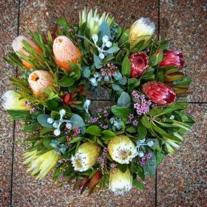 a large fresh wreath made using native wildflowers.