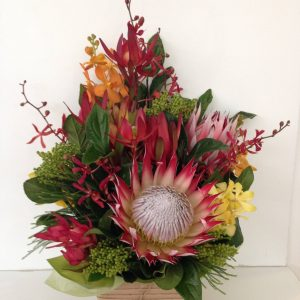 a box arrangement using native wildflowers and foliages with other seasonal flowers. earthy colours.