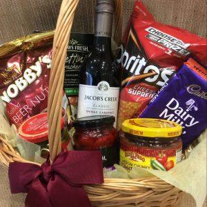 a wicker basket filled with seasonal snacks.
