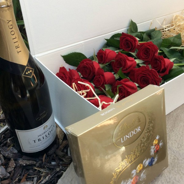 a presentation box of 12 long-stem red roses with a 750ml bottle of Australian sparkling wine and a box of Lindt chocolates.