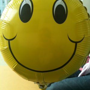 an 18 inch smiley face helium balloon