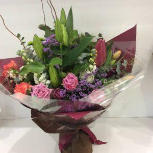 a posy style bouquet in rich feminine tones.