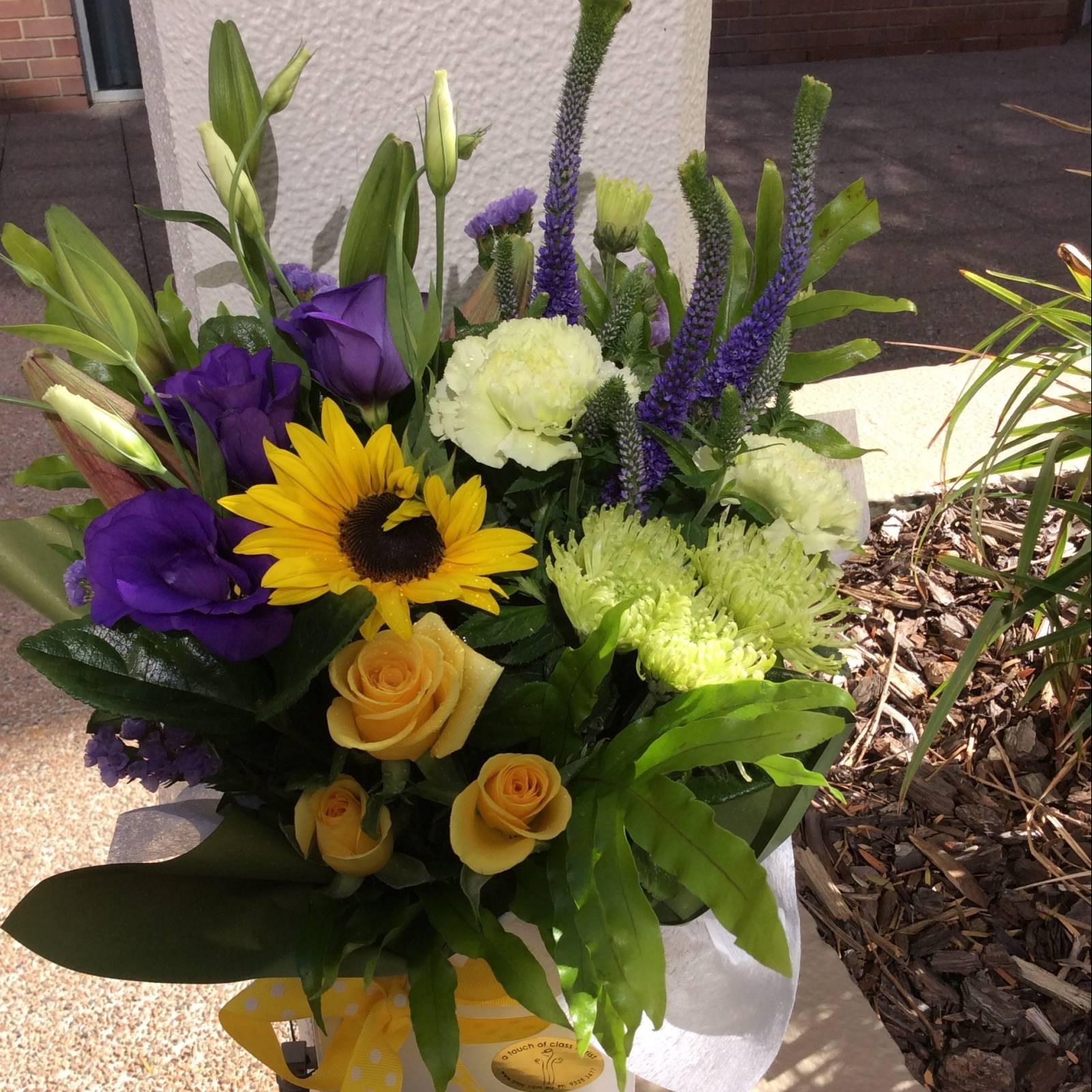 Wow Flowers Arrangement • A Touch of Class Florist