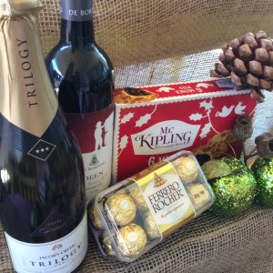 a bottle of sparkling wine, red wine, box of mince pies and ferrero rochers.