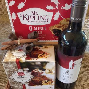 mr kipling mince pies, a christmas fruit cake, and a bottle of red wine.