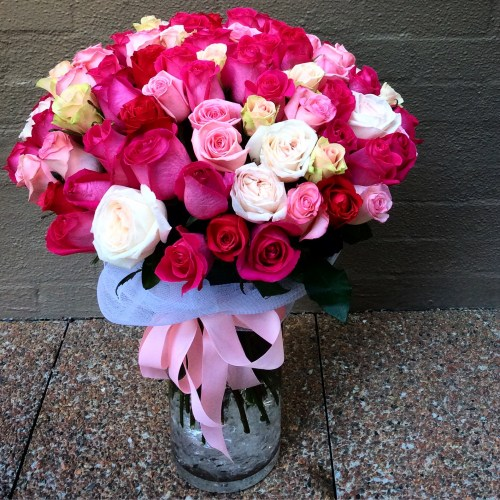 100 roses in shades of pink in a vase- A Touch of Class Florist