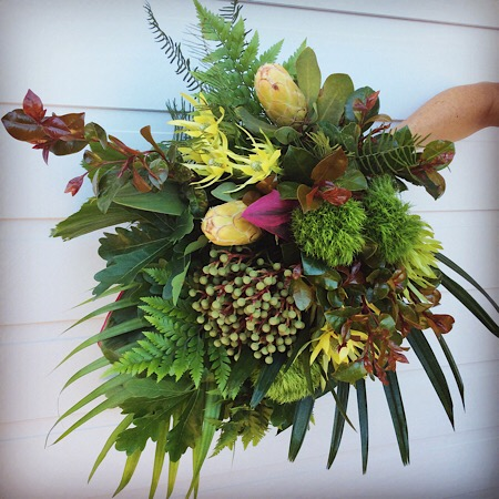 A textural hand-tied bouquet of a variety of seasonal foliage
