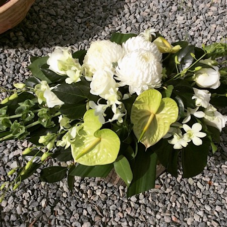 Long and Low Floral arrangement in white and green, a beautiful addition to any table- A touch of Class Florist