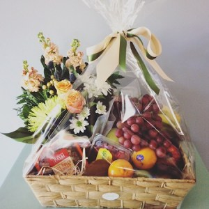 A delightful hamper of fresh fruit and flowers