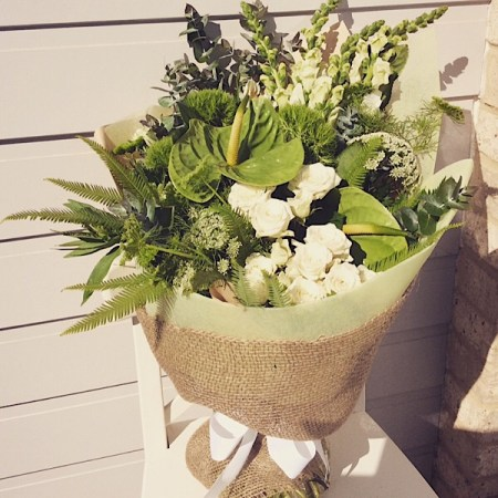 Beautiful and elegant hand-tied bouquet in white and green- A touch of Class Florist