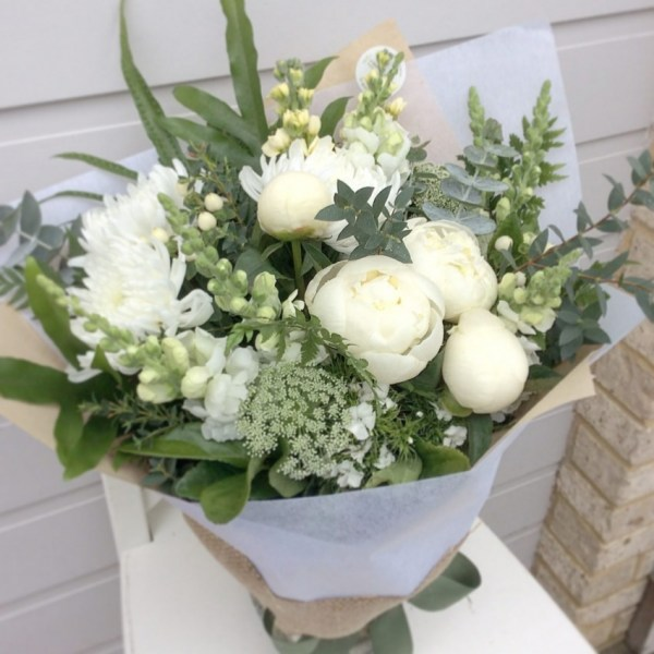 A white and green handtied bouquet of flowers - A touch of Class Florist