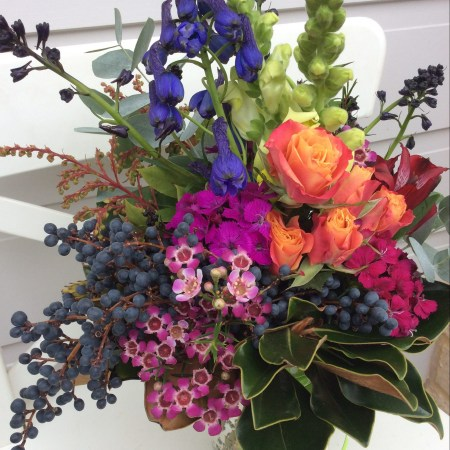 A bright jam jar vase arrangement of flowers- A Touch of Class florist