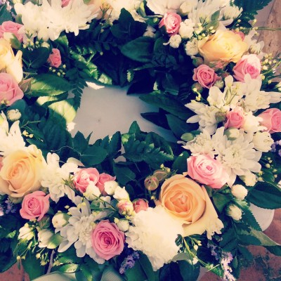 Pastel Wreath a fresh floral wreath in pastel colours- A touch of Class Florist