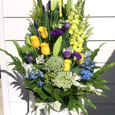 Traditional Formal Flower Arrangement a sympathy arrangement in yellow, purple and blue- A Touch of Class Florist