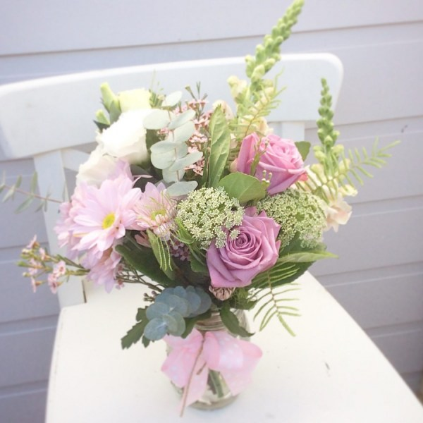 A soft and pretty jam jar vase arrangement - A Touch of Class Florist
