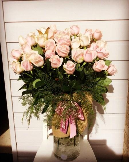 50 pink roses in a vase