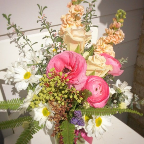 a cute feminine jam jar vase arrangement