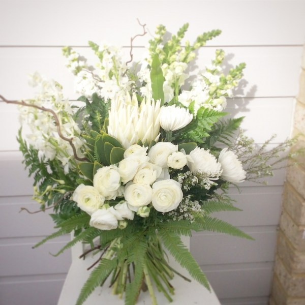a bouquet of white and green flowers