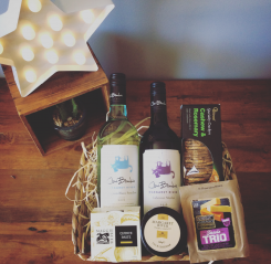 a seagrass hamper of wine and cheese with seasonal foods