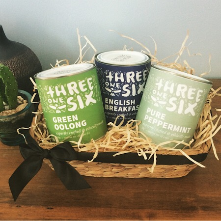 A hamper of three tins of Threeonesix Tea presented in a seagrass basket